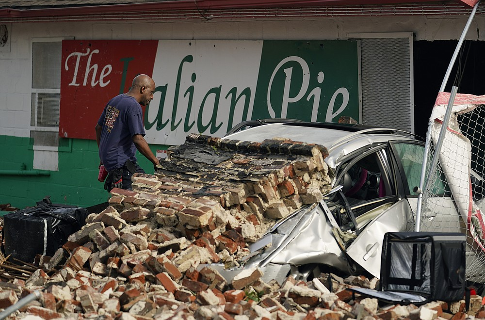 New Orleans Firefighters assess damages as they look through debris after a building collapsed from the effects of Hurricane Ida, Monday, Aug. 30, 2021, in New Orleans, La. (AP Photo/Eric Gay)