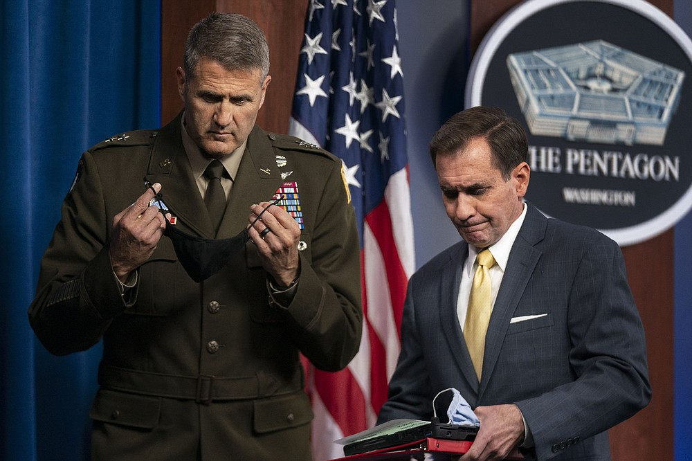 Pentagon spokesman John Kirby with U.S. Army Maj. Gen. William Taylor, Joint Staff Operations, conclude a briefing about the situation in Afghanistan at the Pentagon in Washington, Monday, Aug. 30, 2021. (AP Photo/Manuel Balce Ceneta)