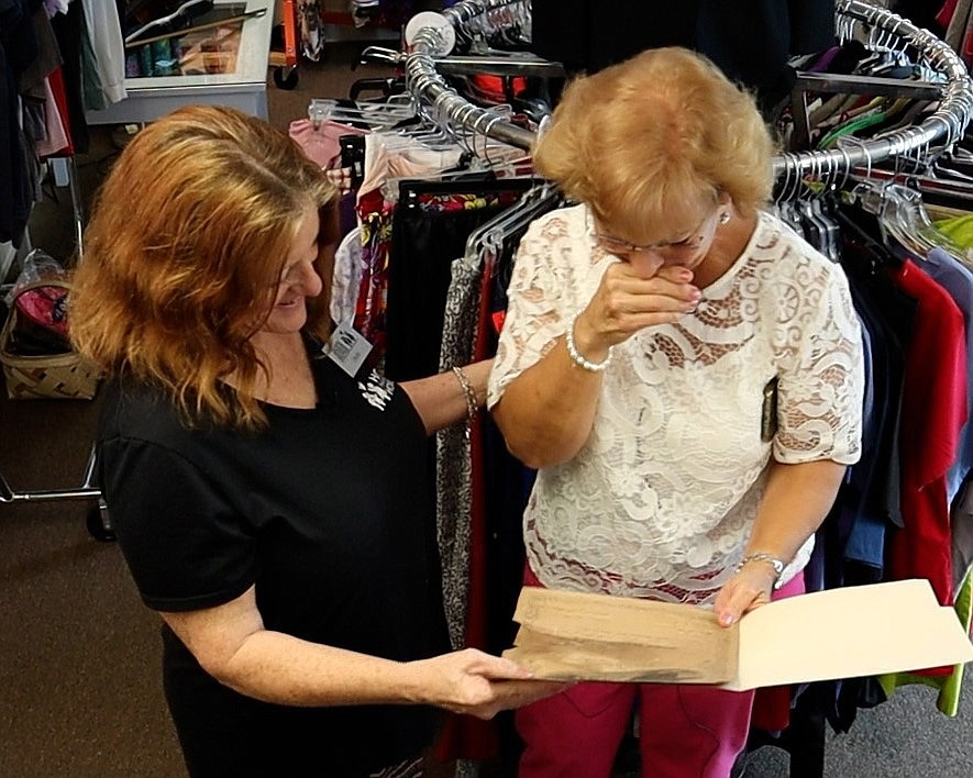 Irene Cornish was moved to tears when she first held the marriage certificate. Pam Phelps, left, was the thrift store manager who originally found the nearly 150-year-old document. (MUST CREDIT: Photo courtesy of Connie Knox)