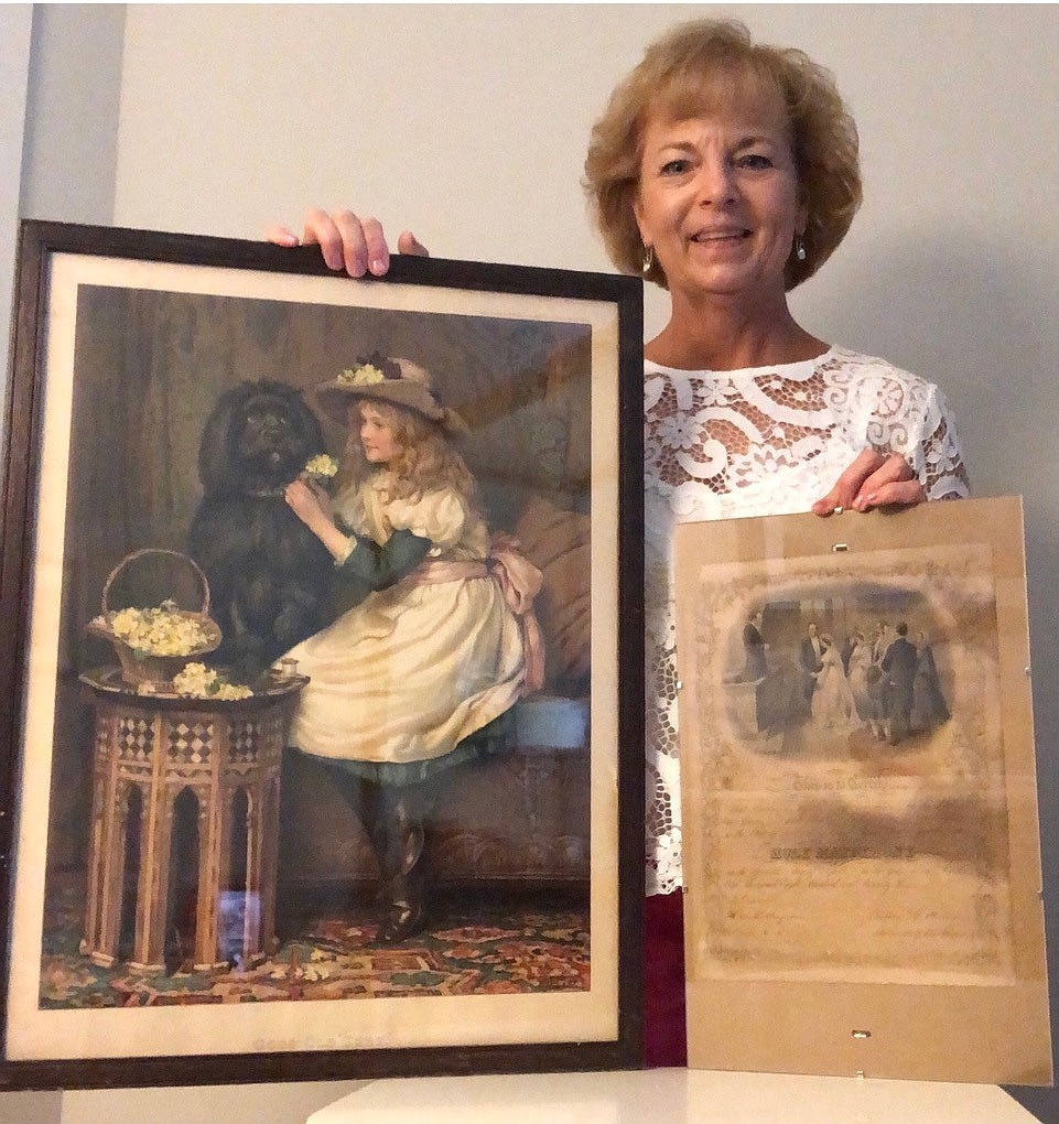Irene Cornish, the great-granddaughter of Katharine Havey DeWorth and William Tindall DeWorth, now possesses their marriage certificate, as well as the large picture frame in which it was hidden. (MUST CREDIT: Photo courtesy of Irene Cornish)