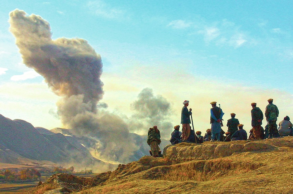 ADVANCE FOR PUBLICATION ON FRIDAY, SEPT. 10, AND THEREAFTER - FILE - In this Nov. 19, 2001 file photo, Northern Alliance soldiers watch as U.S. air strikes attack Taliban positions in Kunduz province, Afghanistan. (AP Photo/Ivan Sekretarev, File)