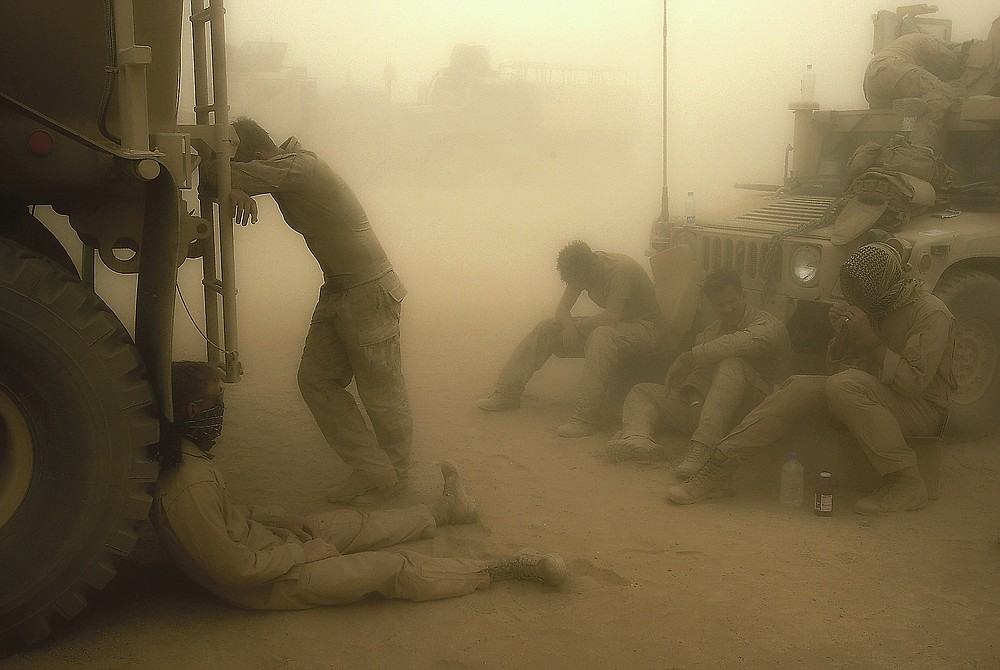 ADVANCE FOR PUBLICATION ON FRIDAY, SEPT. 10, AND THEREAFTER - FILE - In this Wednesday, May 7, 2008 file photo, U.S. Marines from the 24th Marine Expeditionary Unit try to take shelter from a sand storm at forward operating base Dwyer in the Helmand province of southern Afghanistan. (AP Photo/David Guttenfelder, File)