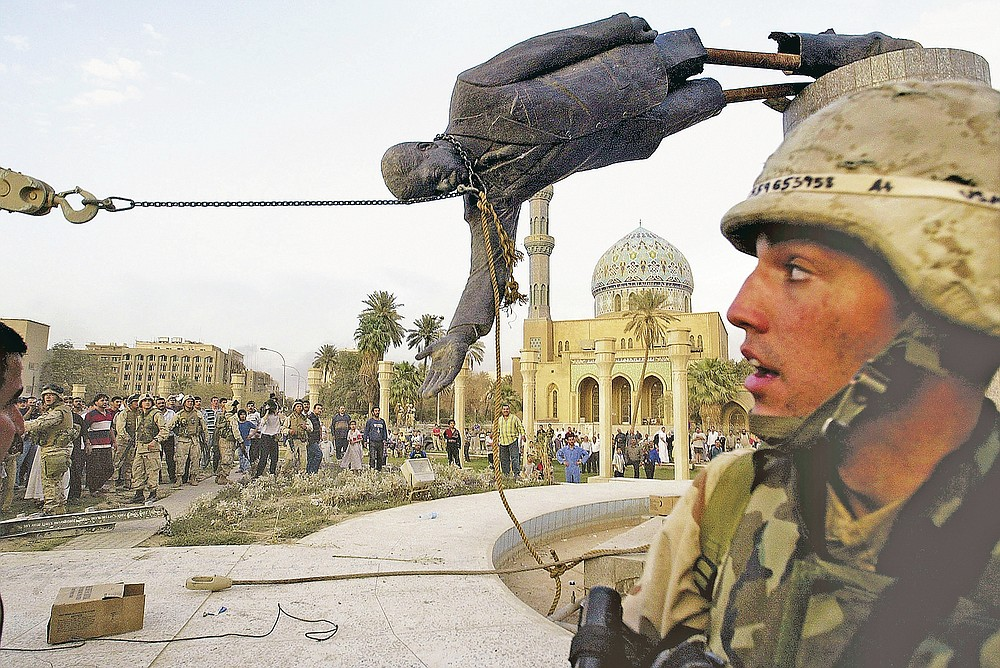 ADVANCE FOR PUBLICATION ON FRIDAY, SEPT. 10, AND THEREAFTER - FILE - Iraqi civilians and U.S. soldiers pull down a statue of Saddam Hussein in downtown Baghdad, in this April 9, 2003 file photo. The U.S. invaded Iraq on false claims that Hussein was hiding weapons of mass destruction. (AP Photo/Jerome Delay, File)