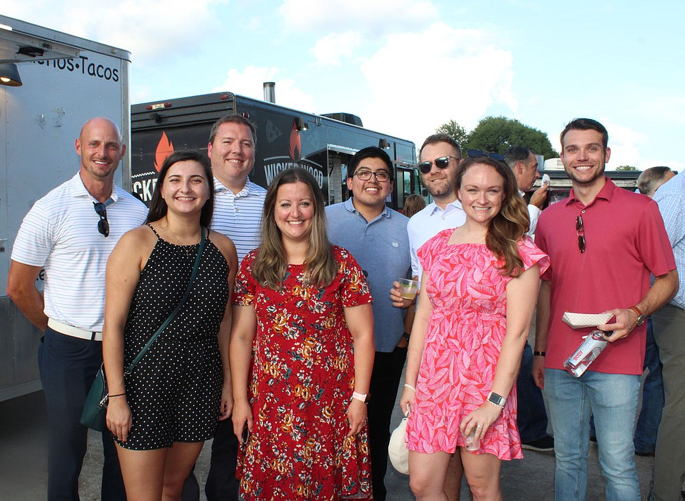 Mike Klaas (from left), Kaycee Hightower, Matt Malone, Shelby Manning, Jonathan Rojo, Eric Plummer, Ashley Garske and Caleb Gray represent General Mills and help support the Boys & Girls Club of Benton County at Sip & Savor on Aug. 19 in Rogers. (NWA Democrat-Gazette/Carin Schoppmeyer)