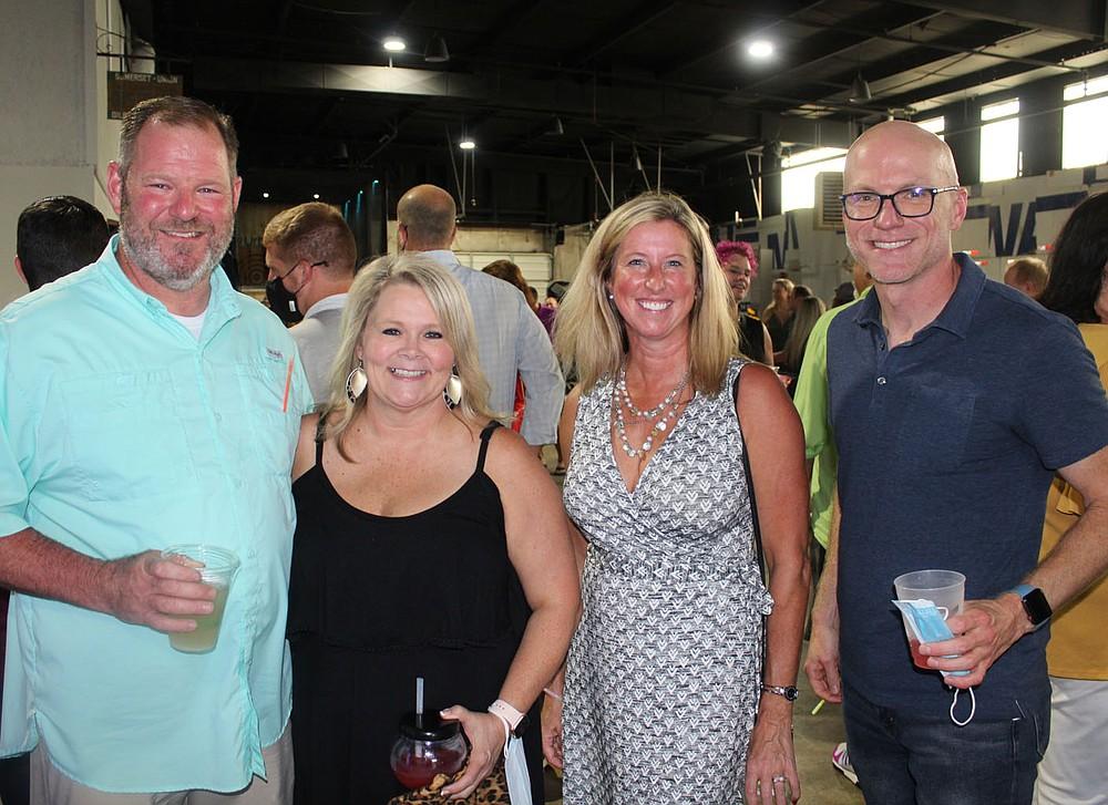 Brian and Cheryl Yarbrough (from left) and Nicki Kappler and Kenneth Medlin attend Sip & Savor. (NWA Democrat-Gazette/Carin Schoppmeyer)