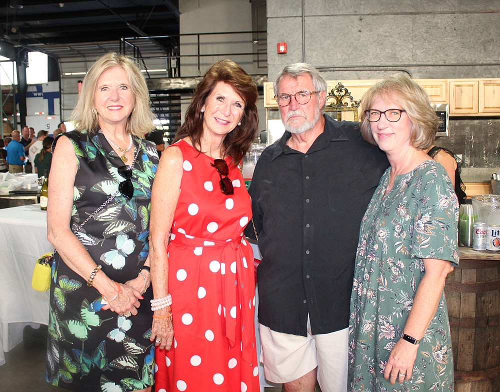 Claire Klinker (from left), Cynthia Coughlin and Tom and Ruthanne Hough visit at Sip & Savor. (NWA Democrat-Gazette/Carin Schoppmeyer)