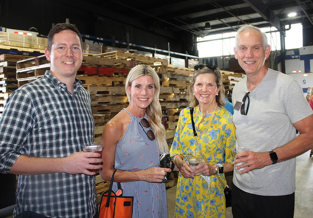 Charles Greathouse and Brooke Shaw (from left) and Beth and Tregg Brown, Boys & Girls Club board member, gather at Sip & Savor. (NWA Democrat-Gazette/Carin Schoppmeyer)