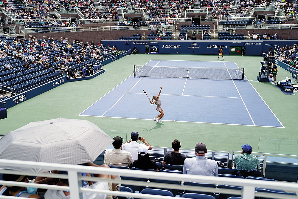 Camila Giorgi of Italy serves Simona Halep of Romania in the first round of the US Open tennis championships on Monday, August 30, 2021, in New York City.  (AP Photo / John Minchillo)