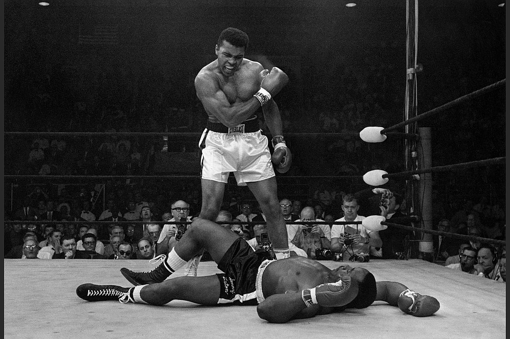 Muhammad Ali stands over fallen Sonny Liston, shouting and gesturing, shortly after dropping Liston with a short hard right to the jaw in Lewiston, Maine on May 25, 1965. (Courtesy of PBS)