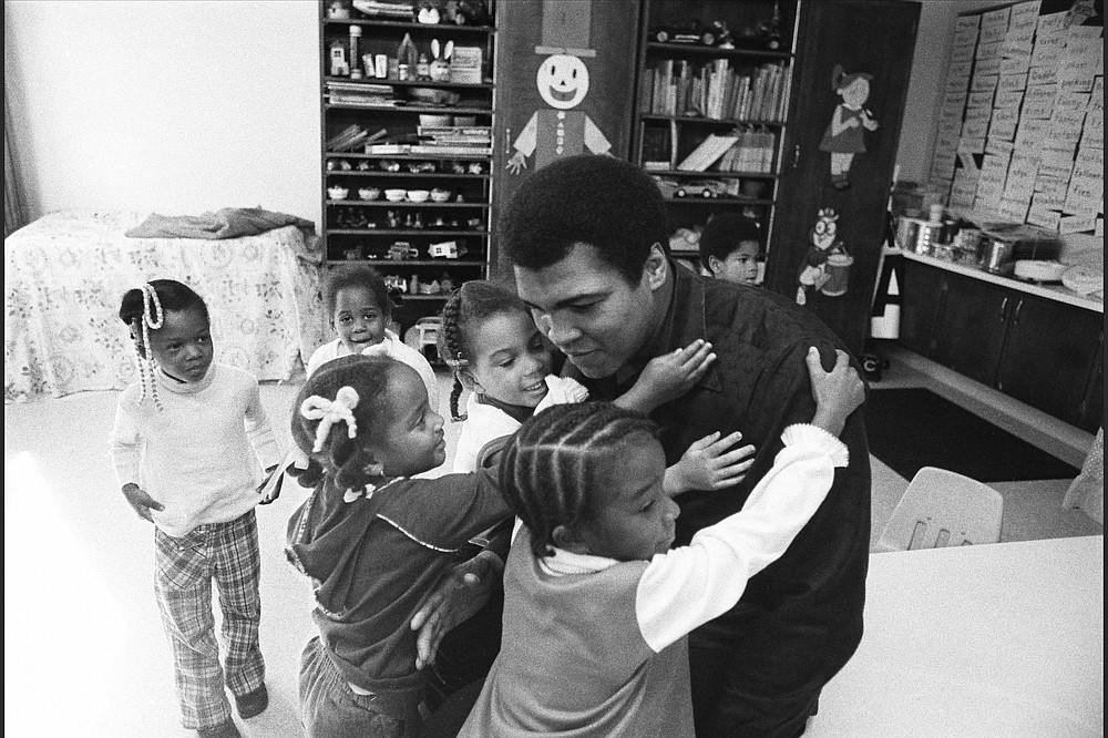 Muhammad Ali is surrounded by young students during a visit to his old grammar school in Louisville, Ky, circa 1977. (Courtesy of PBS)