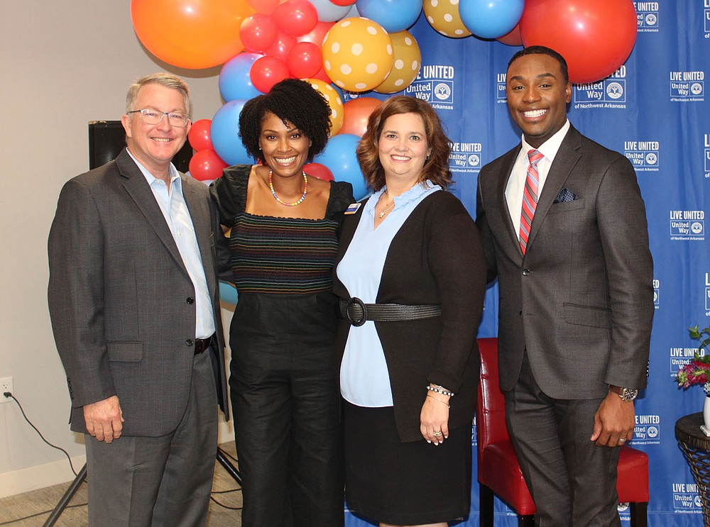 Jackie Hancock, UWNWA CEO and president (from left), Danyell Musselman, Christina Hinds, UW vice president of corporate engagement and Tavares Jones stand for a photo at the kickoff luncheon.  (NWA Democrat-Gazette/Carin Schoppmeyer)