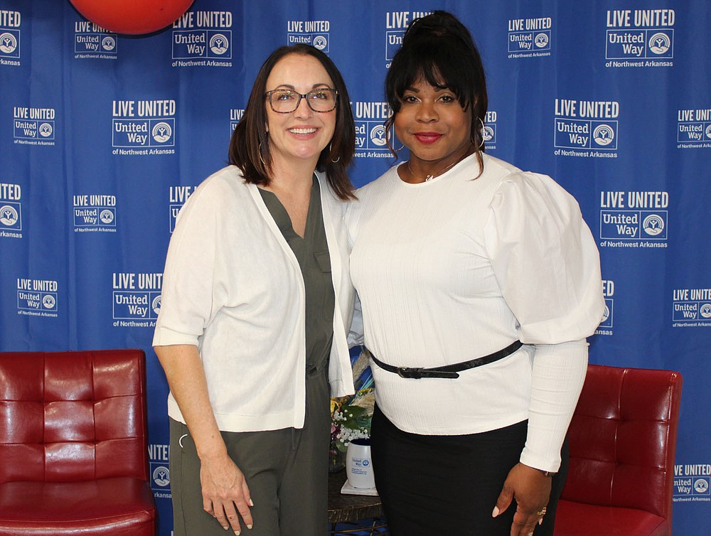 Missy Cole (left) and Helena Gadison, UWNWA board members, stand for a photo at the kickoff luncheon. (NWA Democrat-Gazette/Carin Schoppmeyer)