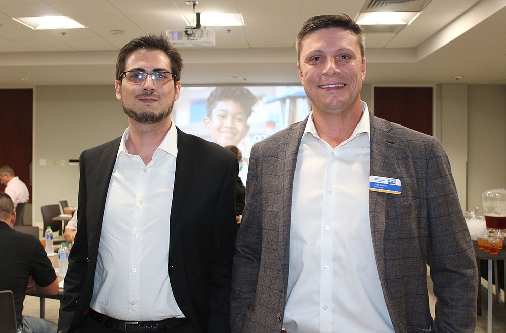 Kyle Powell (left) and Chad Chance, UWNWA board member, visit at the kickoff luncheon. (NWA Democrat-Gazette/Carin Schoppmeyer)