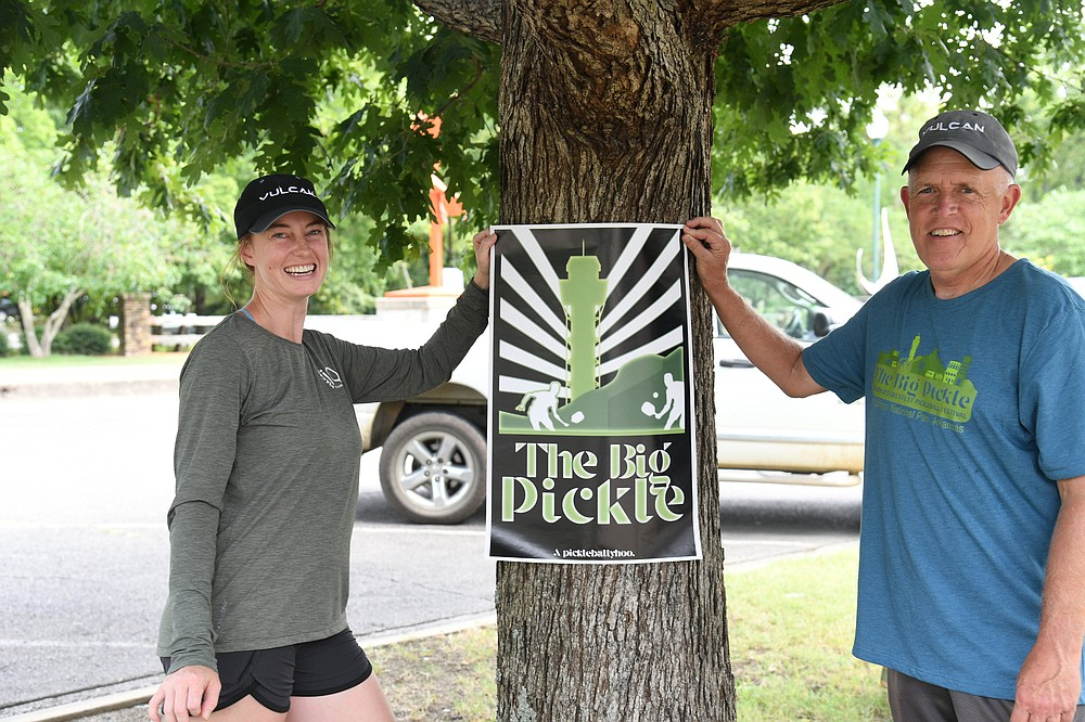 Kate Tully, left and David Tappe show off a poster for The Big Pickle, a pickleball festival, at Garland County Veterans Memorial and Military Park.- Photo by Tanner Newton of The Sentinel-Record