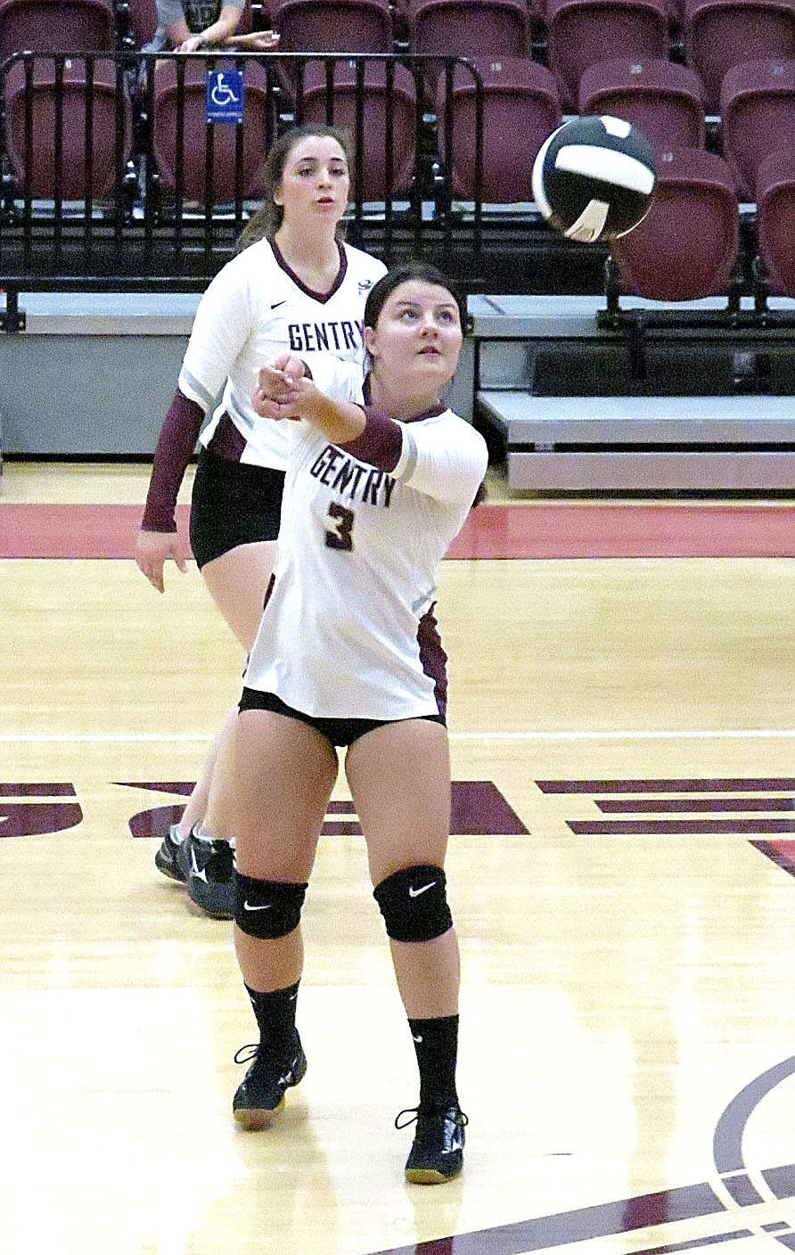 Westside Eagle Observer/RANDY MOLL Gentry junior Afton Finnell receives a serve during play against Huntsville at Gentry High School on Thursday.