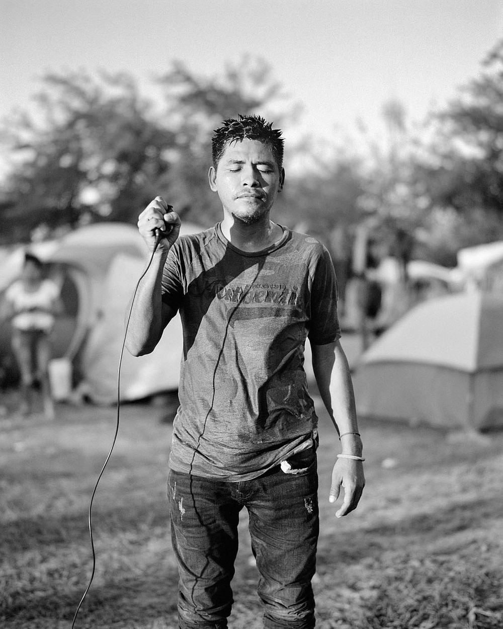 Adam Ferguson, Linifir L?pez, 33, informal migrant camp, Reynosa, Mexico, 2021, 60 x 48 inches, archival pigment print, courtesy of the artist. this image is part of Migrantes, an exhibit at Windgate Museum of Art at Hendrix college DO NOT CROP