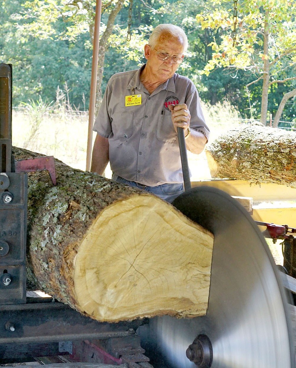 Westside Eagle Observer/RANDY MOLL Herman Smith, of Hiwasse, operates the sawmill at the Tired Iron of the Ozarks showground on Friday, Sept. 6, 2019.
