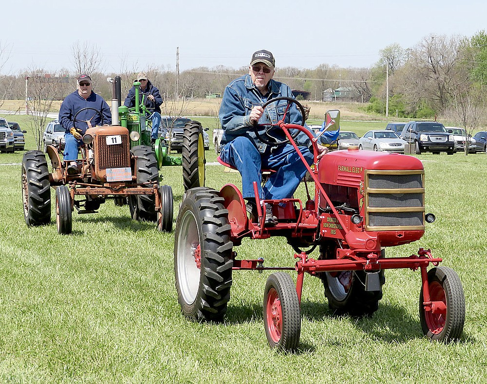 Westside Eagle Observer/RANDY MOLL Don Christensen of Gentry drives an electric tractor during the parade of power at noon on Friday, April 20, 2018, at the spring show of the Tired Iron of the Ozarks in Gentry. He converted the 1949 Farmall Cub to an electric-powered tractor in 2015 and has entered it in the show and numerous parades.