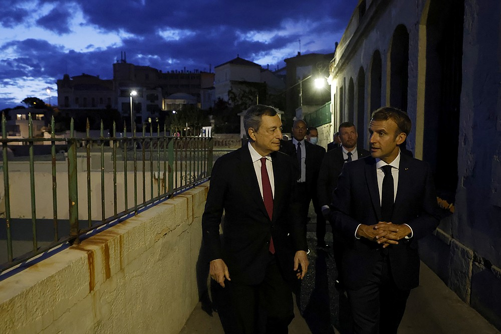 French President Emmanuel Macron, right, and Italian Prime Minister Mario Draghi walk before a dinner Thursday Sept. 2, 2021, as part of his three-day visit in Marseille, southern France. (Ludovic Marin, Pool photo via AP)
