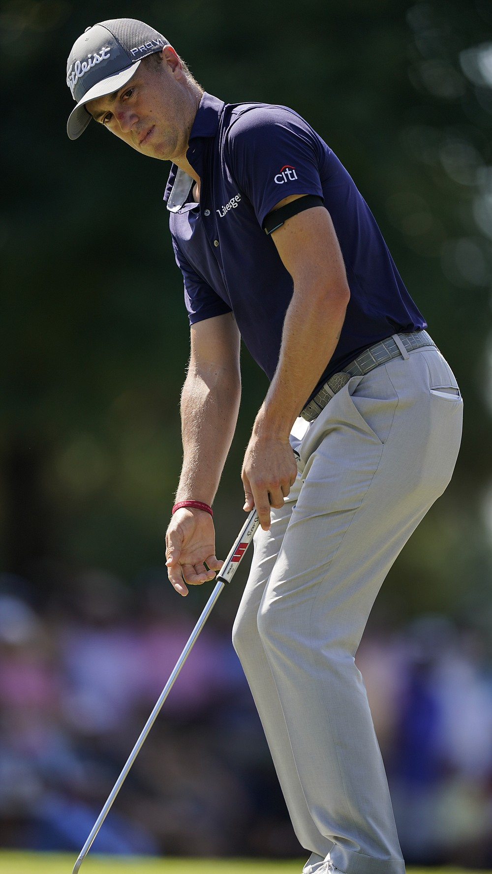 Justin Thomas reacts after his putt on the first green during the third round of the Tour Championship golf tournament Saturday, Sept. 4, 2021, at East Lake Golf Club in Atlanta. (AP Photo/Brynn Anderson)