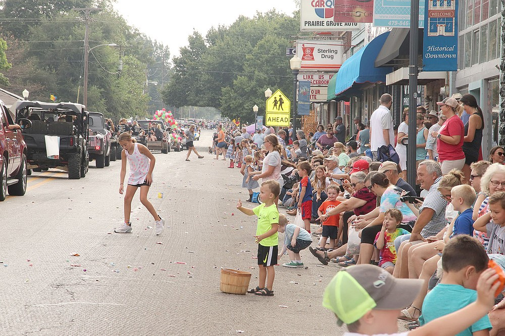Downtown Prairie Grove was crowded on both sides as families lined up to watch the Clothesline Parade. The street was strewn with lots of candy for children to enjoy later in the day. The parade included square dance groups, tractors, businesses, nonprofit organizations, police and fire vehicles.