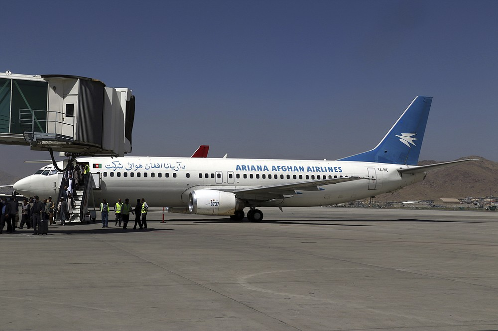 Passengers disembark as they arrive from Kandahar, at Hamid Karzai International Airport in Kabul, Afghanistan, Sunday, Sept. 5, 2021. Some domestic flights have resumed at Kabul's airport, with the state-run Ariana Afghan Airlines operating flights to three provinces. (AP Photo/Wali Sabawoon)