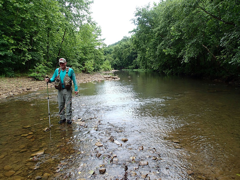 It's wade fishing, but Bodishbaugh rarely gets in above his ankles when streams are low during summer.  (NWA Democrat-Gazette/Flip Putthoff)