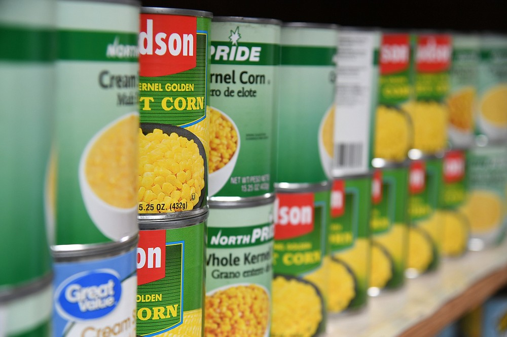 Cans of corn sit in the Salvation Army's food pantry on Tuesday. - Photo by Tanner Newton of The Sentinel-Record