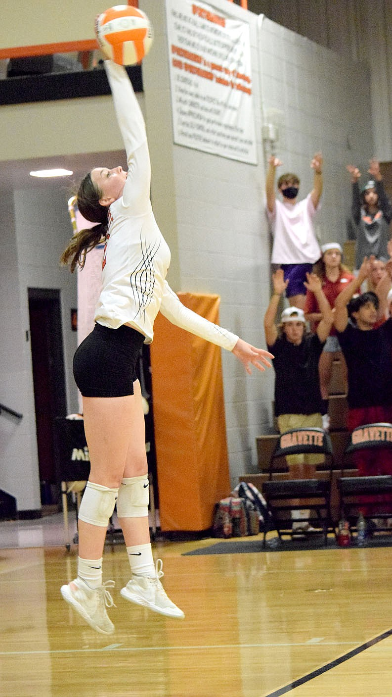 Westside Eagle Observer/MIKE ECKELS Abby Smith serves the ball to the Lady Bobcat side of the court during the second set of the Decatur-Berryville volleyball match in Gravette Thursday night. Smith's serve set up a long volley between the two teams which ended with the Lady Bobcats capturing the point.