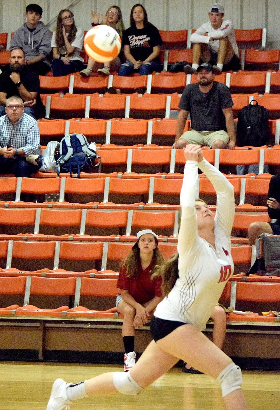 Westside Eagle Observer/MIKE ECKELS After chasing the ball into the Lady Lion back court, Keeley Elsea manages to hit it back to the front line where a team mate sent it over the net during the third set of the Gravette-Berryville varsity volleyball match in Gravette Thursday night. The Lady Lions claimed the win in three sets over the Lady Bobcats.