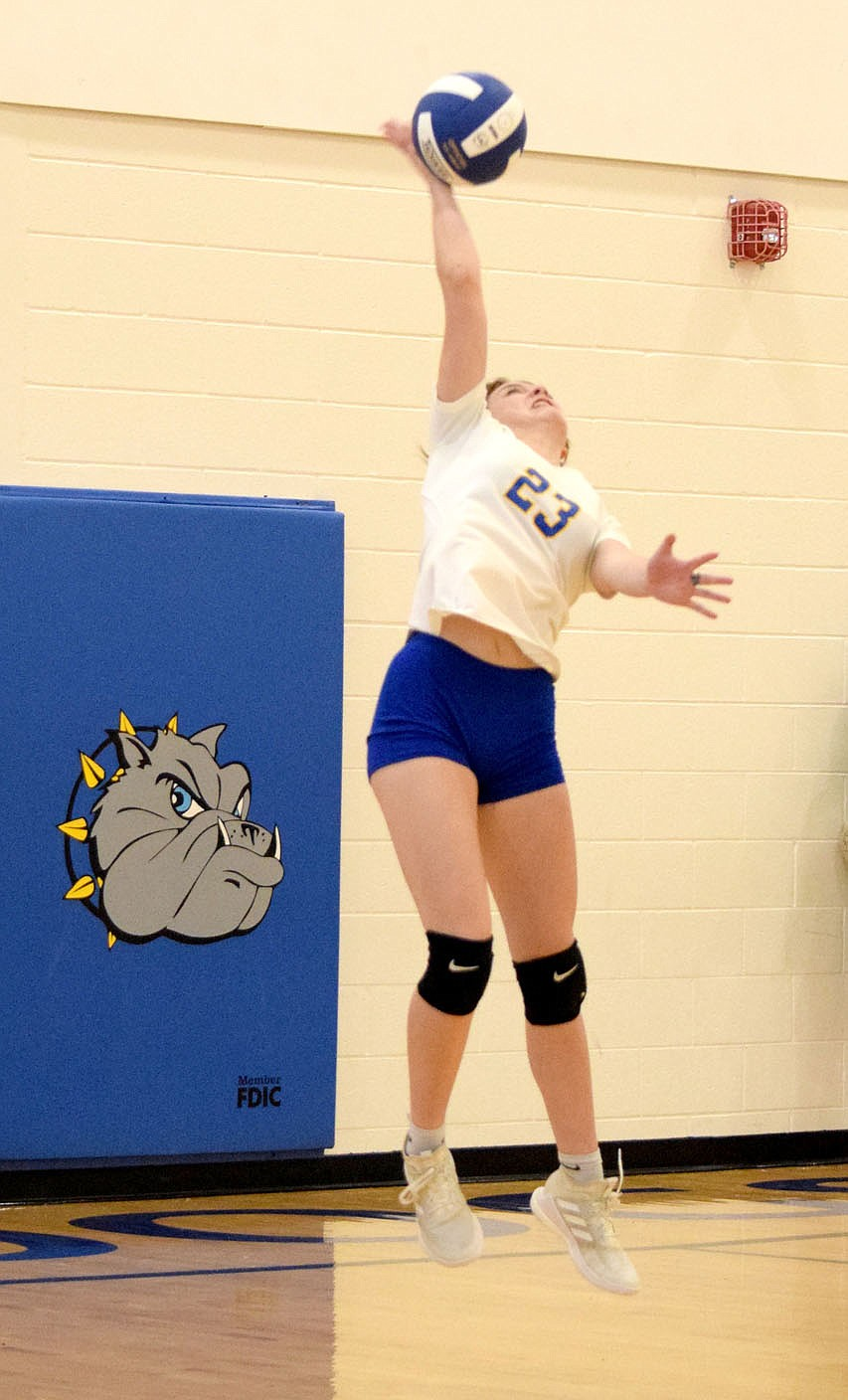 Westside Eagle Observer/MIKE ECKELS Lady Bulldog Brooklyn Todd serves the ball to the Lady Highlander side of the court during the second set of the Decatur-Eureka Springs volleyball match in the gym at Decatur Middle School Sept. 7.