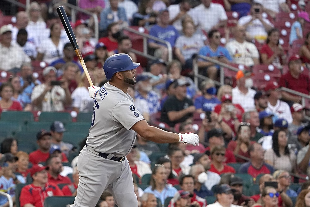 Los Angeles Dodgers' Albert Pujols watches his solo home run during the first inning of a baseball game against the St. Louis Cardinals Tuesday, Sept. 7, 2021, in St. Louis. (AP Photo/Jeff Roberson)