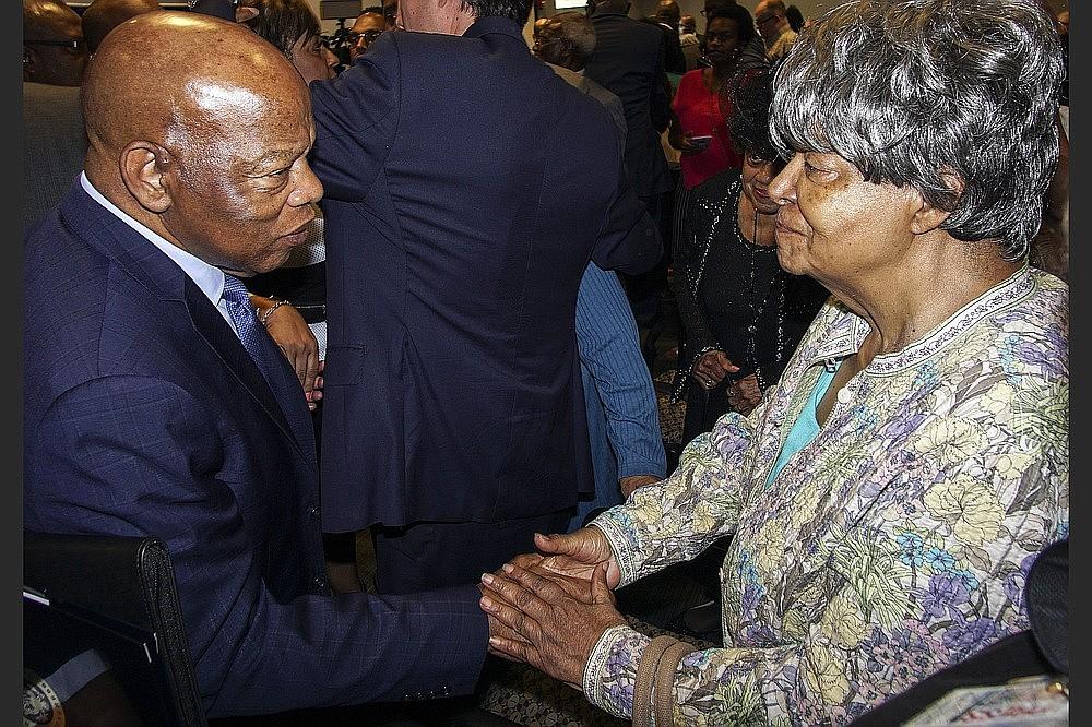 U.S. Rep. John Lewis (left) greets Elizabeth Eckford, one of the Little Rock Nine, after Lewis spoke at Philander Smith College on Aug. 19, 2018. (Democrat-Gazette file photo)