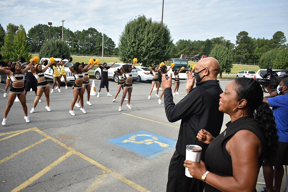 UAPB spirit squad members perform for Pro Football Hall of Famer Drew Pearson as spirit squad Coach Karen Blunt looks on. (Pine Bluff Commercial/I.C. Murrell)