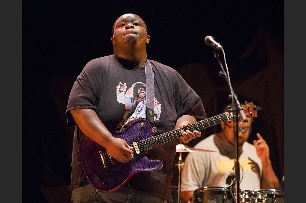 """Christone """"Kingfish"""" Ingram performs as the opening act for Vampire Weekend during their """"Father of the Bride Tour"""" in 2019. """"I can hear music in people's footsteps, and I can hear melodies in the sound of the rain and the blowing wind,"""" Ingram says. (Owen Sweeney/Invision/AP)"""