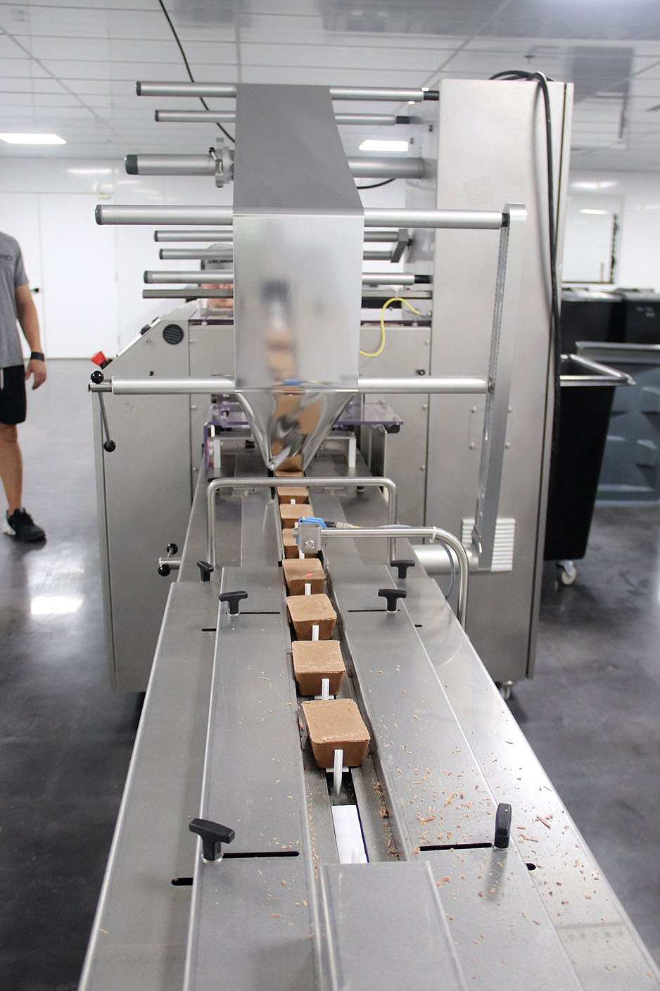 LYNN KUTTER ENTERPRISE-LEADER This conveyer belt takes the Savage Keto Bars into a machine where the bars are covered with a wrapping and then boxed and shipped out across the country.