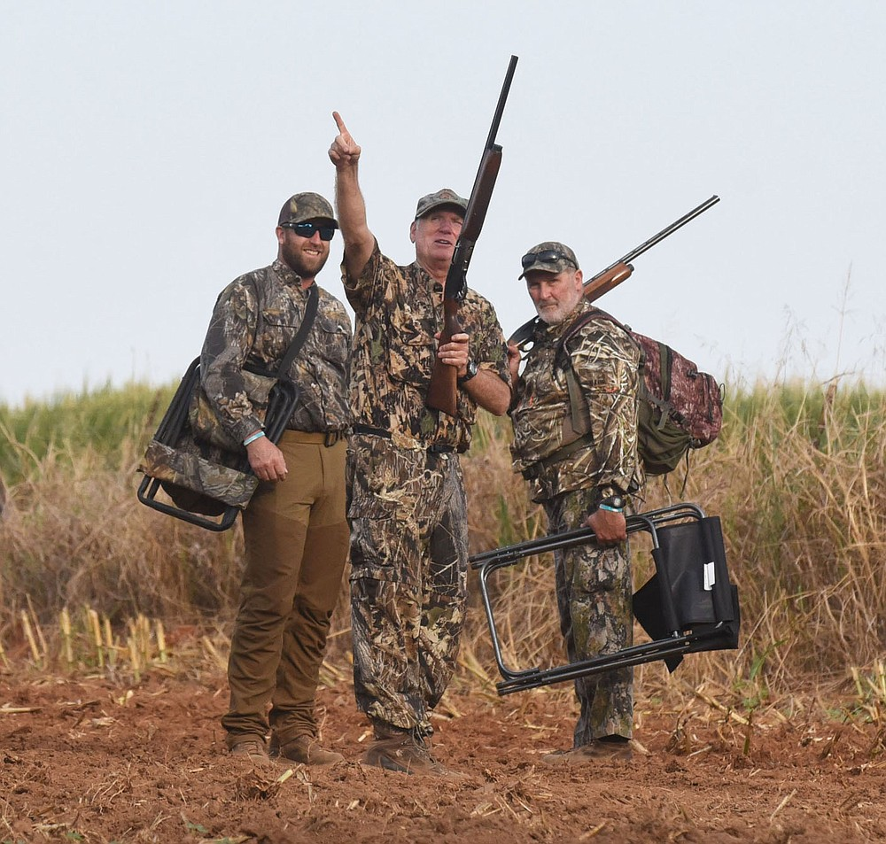 Hunters discuss their success on opening morning Sept. 4 2021 at the Game and Fish permit-only dove field near Prairie Grove. (NWA Democrat-Gazette/Flip Putthoff)
