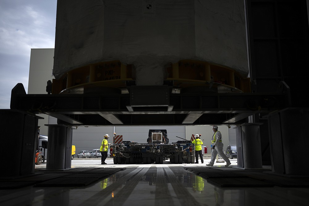 A central solinoid magnet for the ITER project arrives in Saint-Paul-Lez-Durance, France, Thursday, Sept. 9, 2021. Scientists at the International Thermonuclear Experimental Reactor in southern France took delivery of the first part of a massive magnet so strong its American manufacturer claims it can lift an aircraft carrier. (AP Photo/Daniel Cole)