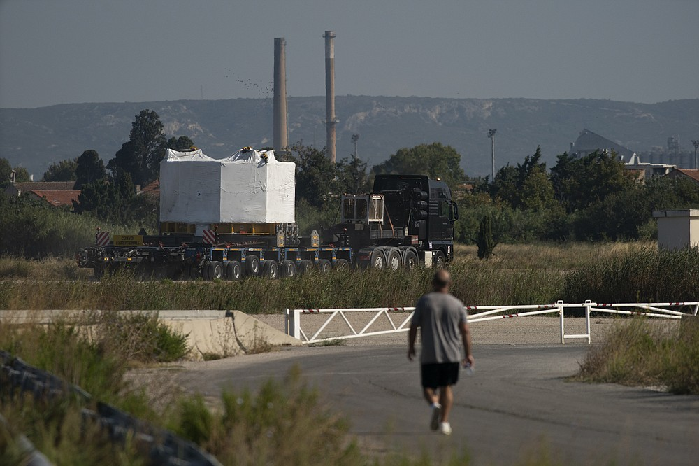 A central solenoid magnet for the ITER project departs from Berre-l'Etang in southern France, Monday, Sept. 6, 2021. The first part of a massive magnet so strong its American manufacturer claims it can lift an aircraft carrier arrived Thursday, Sept. 9, 2021 at a high-security site in southern France, where scientists hope it will help them build a 'sun on earth.' Almost 60-feet tall and 14 feet in diameter when fully assembled, the magnet is a crucial component of the International Thermonuclear Experimental Reactor, or ITER, a 35-nation effort to develop an abundant and safe source of nuclear energy for future generations. (AP Photo/Daniel Cole)