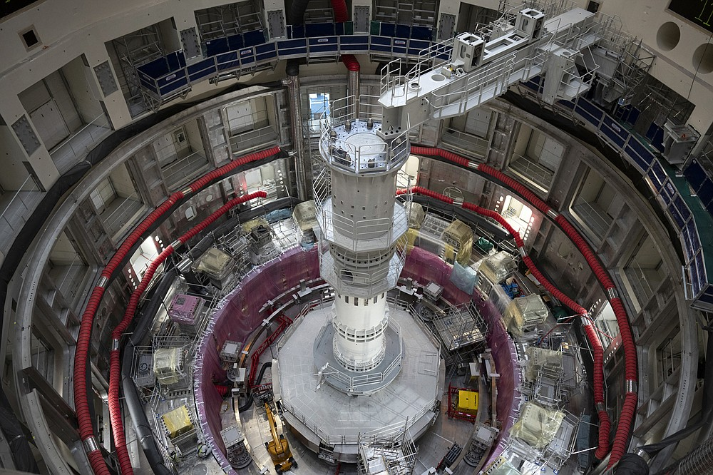 The ITER Tokamak machine is pictured in Saint-Paul-Lez-Durance, France, Thursday, Sept. 9, 2021. Scientists at the International Thermonuclear Experimental Reactor in southern France took delivery of the first part of a massive magnet so strong its American manufacturer claims it can lift an aircraft carrier. (AP Photo/Daniel Cole)