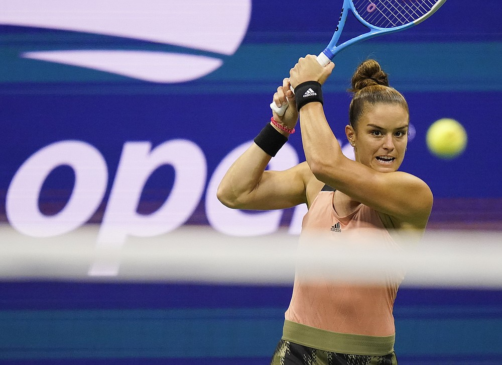 Maria Sakkari, of Greece, returns a shot to Emma Raducanu, of Great Britain, during the semifinals of the US Open tennis championships, Thursday, Sept. 9, 2021, in New York. (AP Photo/Frank Franklin II)
