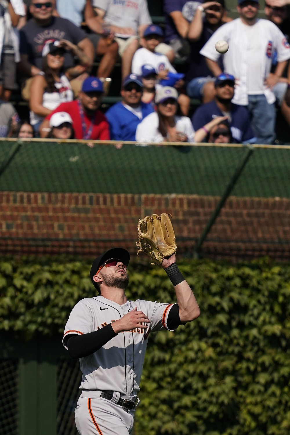 San Francisco Giants left fielder Kris Bryant catches a fly ball hit by Chicago Cubs' Ian Happ during the sixth inning of a baseball game in Chicago, Friday, Sept. 10, 2021. (AP Photo/Nam Y. Huh)
