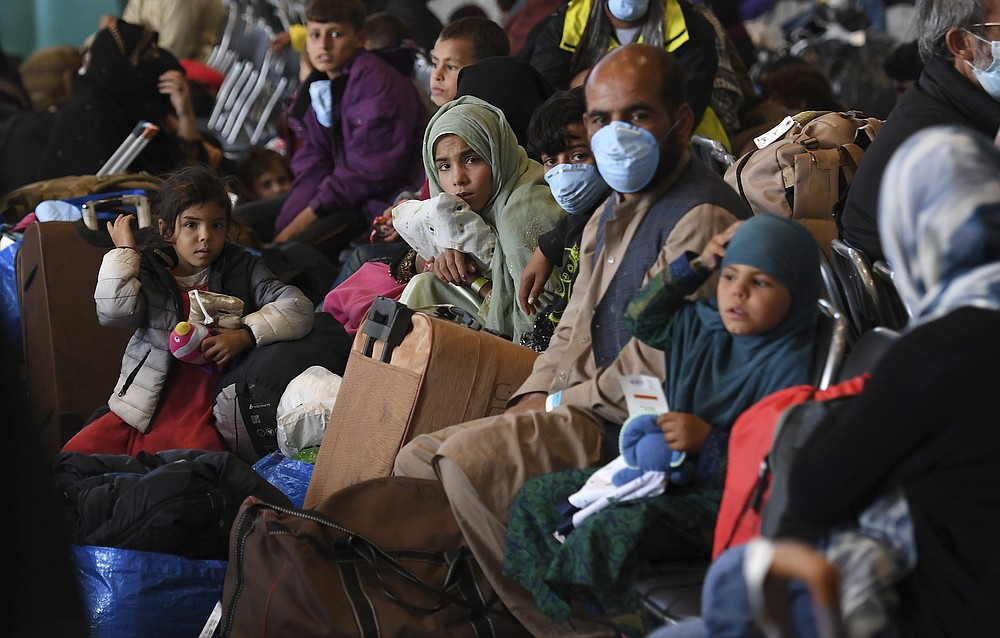 Afghan refugees are processed inside Hangar 5 at theRamstein U.S. Air Base in Germany Wednesday, Sept. 8, 2021. U.S. Secretary of State Antony Blinken arrived at the base where he will meet with his German counterpart for talks on Afghanistan. (Olivier Douliery/Pool Photo via AP)
