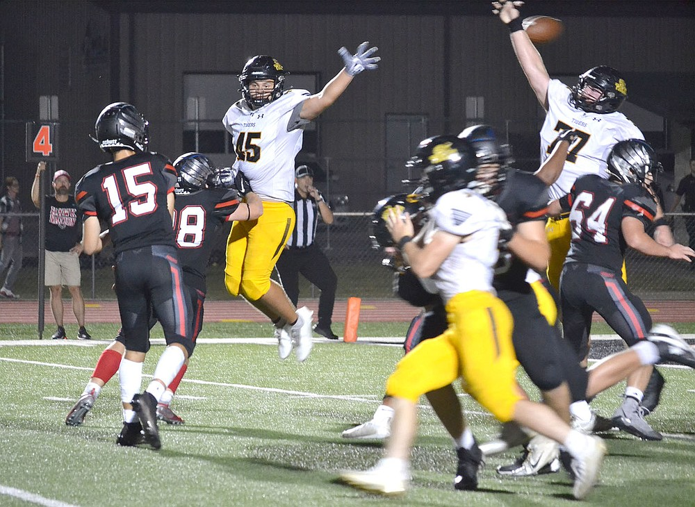 ANNETTE BEARD PEA RIDGE TIMES/Prairie Grove defensive lineman, Matthew Velasco (Tigers No. 45) and Ryder Orr (Tigers No. 77) attempt to block a pass from Blackhawk quarterback Gavin Dixon (No. 15) for the 2-point conversion Friday night in Blackhawk Stadium. Pea Ridge scored 16 points in the fourth, but couldn't overtake Prairie Grove with the Tigers winning 41-28.