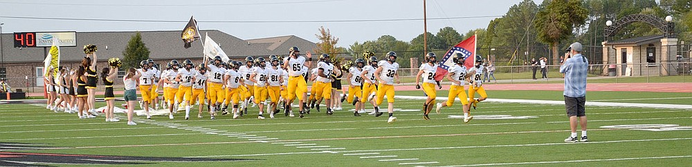 The Prairie Grove Tigers made their entrance Friday, Sept. 10, 2021, onto the field at Blackhawk Stadium