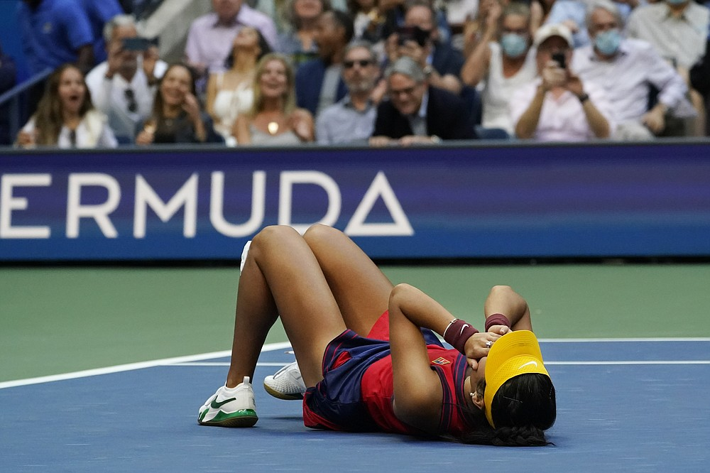 Emma Raducanu, of Britain, lies on the court after defeating Leylah Fernandez, of Canada, during the women's singles final of the US Open tennis championships, Saturday, Sept. 11, 2021, in New York. (AP Photo/Elise Amendola)