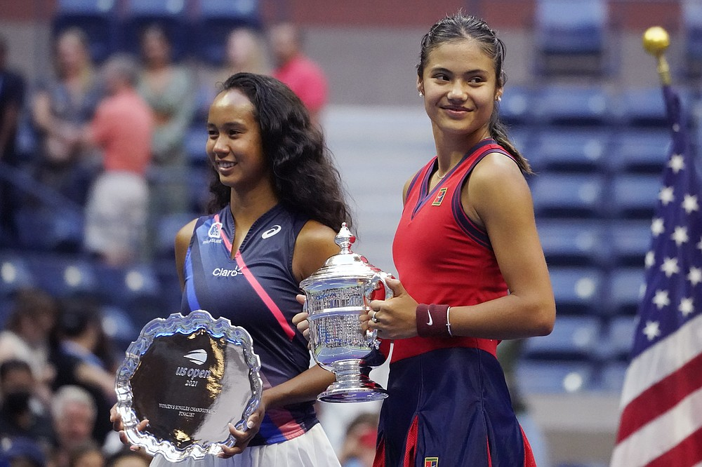 Emma Raducanu, of Britain, right, poses for photos with Leylah Fernandez, of Canada, after defeating Fernandez in the women's singles final of the US Open tennis championships, Saturday, Sept. 11, 2021, in New York. (AP Photo/Elise Amendola)