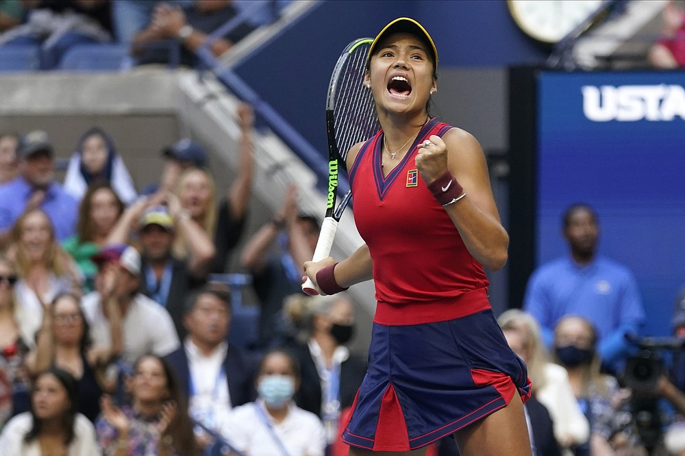 Emma Raducanu, of Britain, reacts after scoring a point against Leylah Fernandez, of Canada, during the women's singles final of the US Open tennis championships, Saturday, Sept. 11, 2021, in New York. (AP Photo/Seth Wenig)