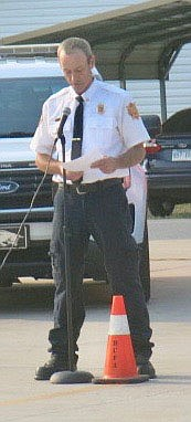 Westside Eagle Observer/SUSAN HOLLAND Gravette fire chief David Orr welcomes guests to the fire department's third annual Sept. 11 remembrance ceremony Saturday morning and reads a brief account of the events of the terrorist attack on the World Trade Center in New York City. This year marked the 20th anniversary of the occasion in which 343 firefighters lost their lives.