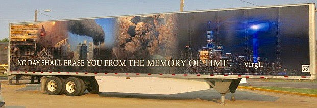Westside Eagle Observer/SUSAN HOLLAND A semi trailer that is part of R&R Solutions trucking fleet memorializes those who lost their lives in the Sept. 11, 2001, terrorist attacks. The trailer, one of a series of vehicles with patriotic designs operated by the company, was parked in CV's parking lot Saturday and served as a dramatic backdrop to the fire department's remembrance ceremony.